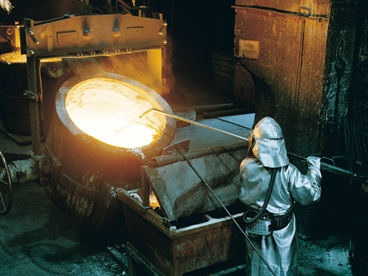 Laborers working in foundry.